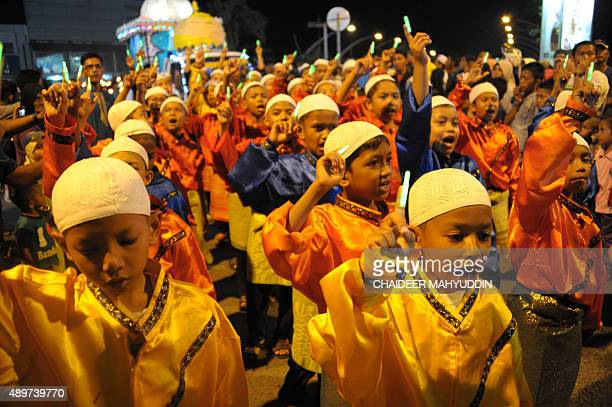 This picture taken on September 23 shows Acehnese boys attending a carnival to welcome the Eid AlAdha festival in Banda Aceh Muslims across the world...