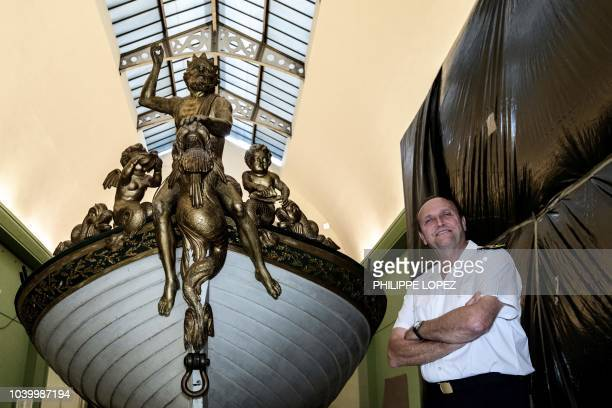 This picture taken on September 24 2018 shows Admiral Vincent Campredon director ot the national navy museum posing in front of France's Imperial...