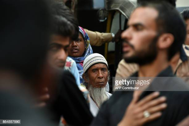 This picture taken on September 26 2017 shows an elderly Indian man watching Shiite Muslims beat their chest during a procession held ahead of Ashura...