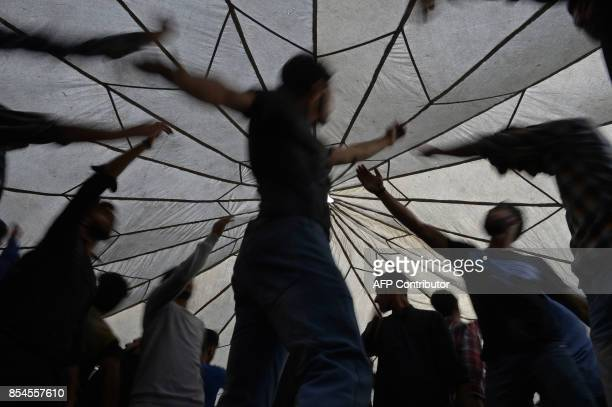 TOPSHOT This picture taken on September 26 2017 shows Indian Kashmiris beating their chests during a Shiite Muslim procession held ahead of Ashura on...