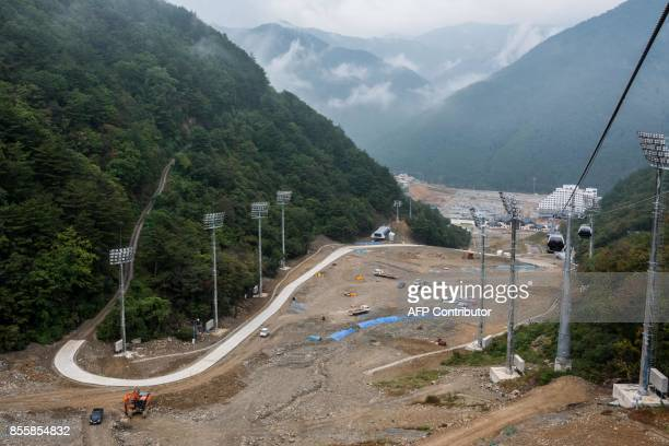 This picture taken on September 27 2017 shows construction works at the Jeongsen Alpine Center where the Alpine Skiing downhill Super G and Combined...