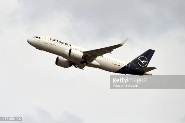 This picture taken on September 27, 2019 shows an Airbus A320 of German company Lufthansa after taking off from the Toulouse-Blagnac airport, near...