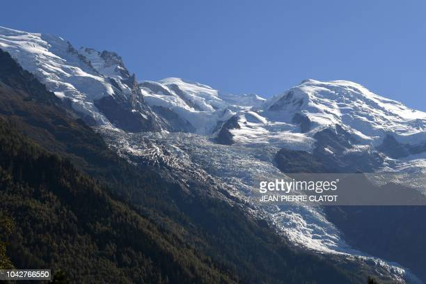 This picture taken on September 28 2018 in ChamonixMont Blanc eastern France shows the summit of MontBlanc peak Dôme du Goûter Mont Maudit and the...