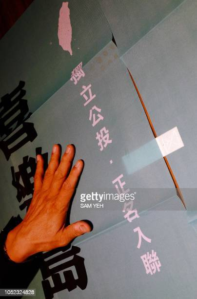 This picture taken on September 28 2018 shows Kuo Peihorng head of Taiwan's new proindependence Formosa Alliance displaying a banner reading...