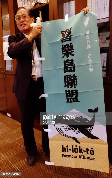 This picture taken on September 28 2018 shows Kuo Peihorng head of Taiwan's new proindependence Formosa Alliance displaying a banner of Formosa...