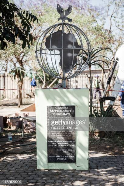 This picture taken on September 28 shows a plaque of the Gandhi Settlement Bhambayi north of Durban. - Gandhi was forced off a train at the...