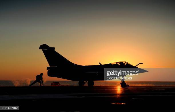 This picture taken on September 29 shows a Rafale Marine combat aircraft being catapulted from the French aircraft carrier Charles de Gaulle as it...