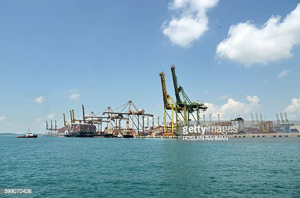 This picture taken on September 3 2016 shows a container vessel berthed at a container terminal in Singapore The problems that sank South Korea's...