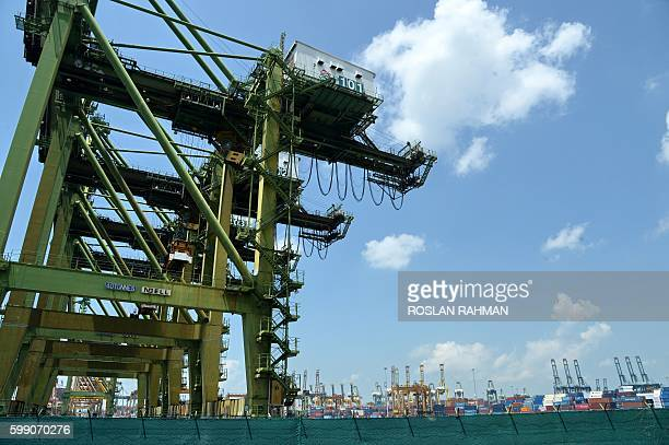 This picture taken on September 3 2016 shows cranes at the container terminal in Singapore The problems that sank South Korea's Hanjin Shipping this...