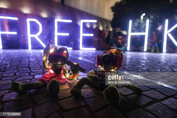 This picture taken on September 30, 2019 shows stuffed toys depicting Pepe the Frog, a character used by pro-democracy activists as a symbol of their...