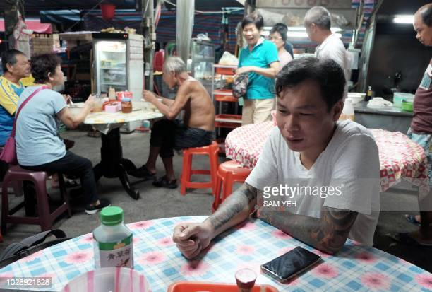 This picture taken on September 4 2018 shows Yen Weishun a former criminal turned noodle shop owner for charity speaking during an interview at his...