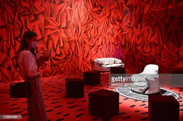 This picture taken on September 4, 2021 a visitor looking at Davids Living Room Revisited by artists Guillermo Kuitca and David Lynch displayed...