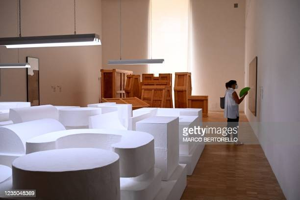 """This picture taken on September 4, 2021 shows visitors looking at """"Propositions dhabitations"""" by artist Absalon displayed during the exhibition Les..."""