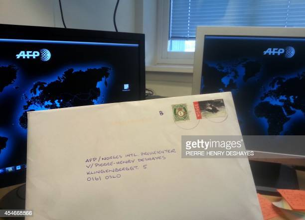 This picture taken on September 5 2014 shows a letter by Norwegian rightwing extremist Anders Behring Breivik addressed to AFP journalist PierreHenry...