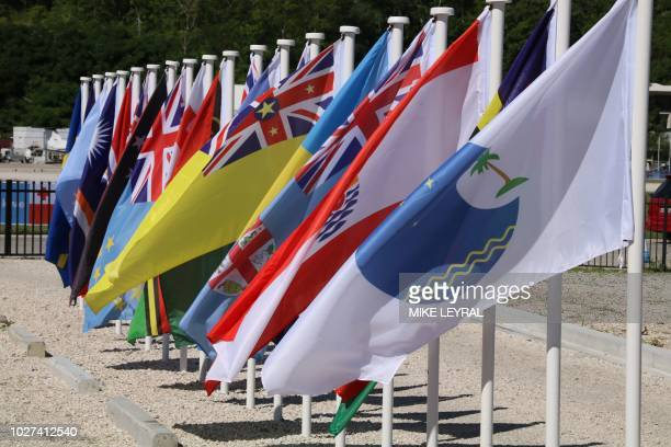 This picture taken on September 5 2018 shows flags from the Pacific Islands countries being displayed in Yaren on the last day of the Pacific Islands...