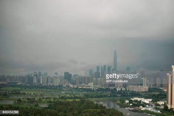 This picture taken on September 6 2017 shows a general view of the Sheung Yue river which divides the border between Hong Kong and the southern...