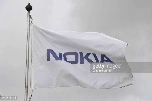 This picture taken on September 7 2015 shows a flag of the Finnish telecommunication network company Nokia in Lannion western France Finnish telecoms...