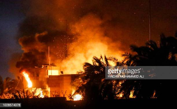 This picture taken on September 7, 2018 shows the burning headquarters of the Iranian consulate in the southern Iraqi city of Basra which was torched...