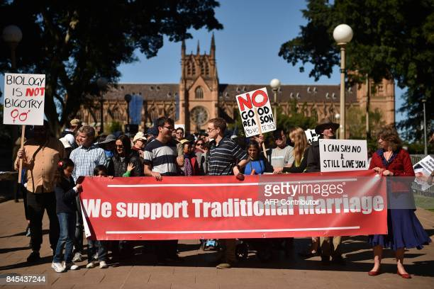 This picture taken on September 9 2017 shows protesters holding up banners at an anti samesex marriage rally in Sydney As Australia prepares for a...