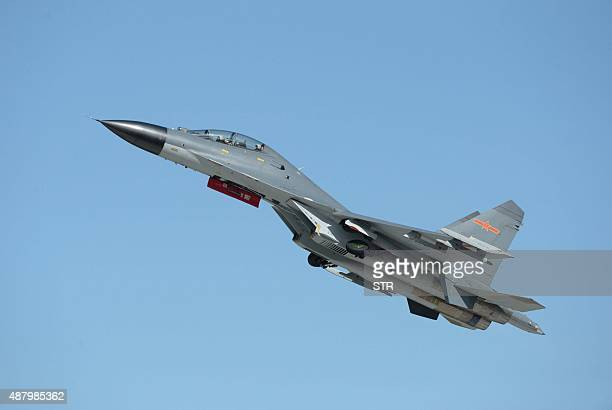 This picture taken on Septernber 12, 2015 shows the J-11B fighter aircraft from the People's Liberation Army Air Force performing at the Dafangshen...