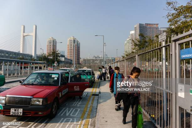 This picture taken outside the Lok Ma Chau MTR station in Hong Kong on February 13 2017 shows mainland residents disembarking with their shopping...