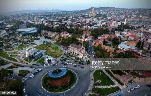 This picture taken using a drone on August 23 2017 shows an aerial view of the Georgian capital of Tbilisi / AFP PHOTO / Vano Shlamov