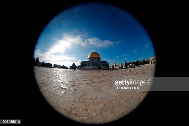 This picture taken with a fisheye lens on January 10 shows the Dome of the Rock mosque at the AlAqsa mosque compound in Jerusalem's Old City...