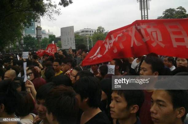 This picture taken with a mobile phone on April 3 2014 shows protesters rallying against a plant producing paraxylene in front of the government...