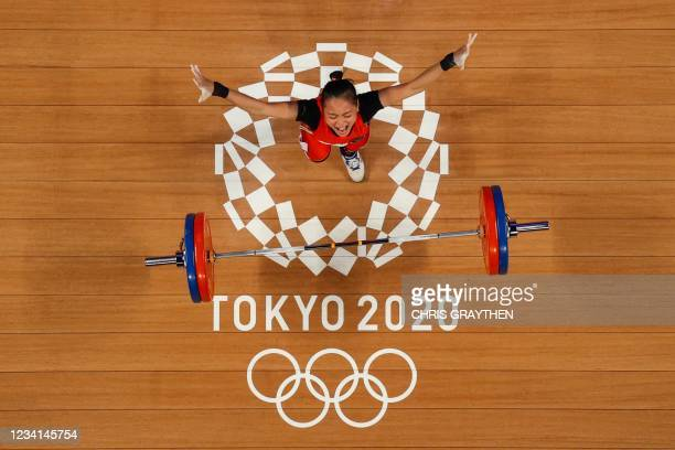 This picture taken with a robotic camera shows Indonesia's Windy Cantika Aisah reacting while competing in the women's 49kg weightlifting competition...