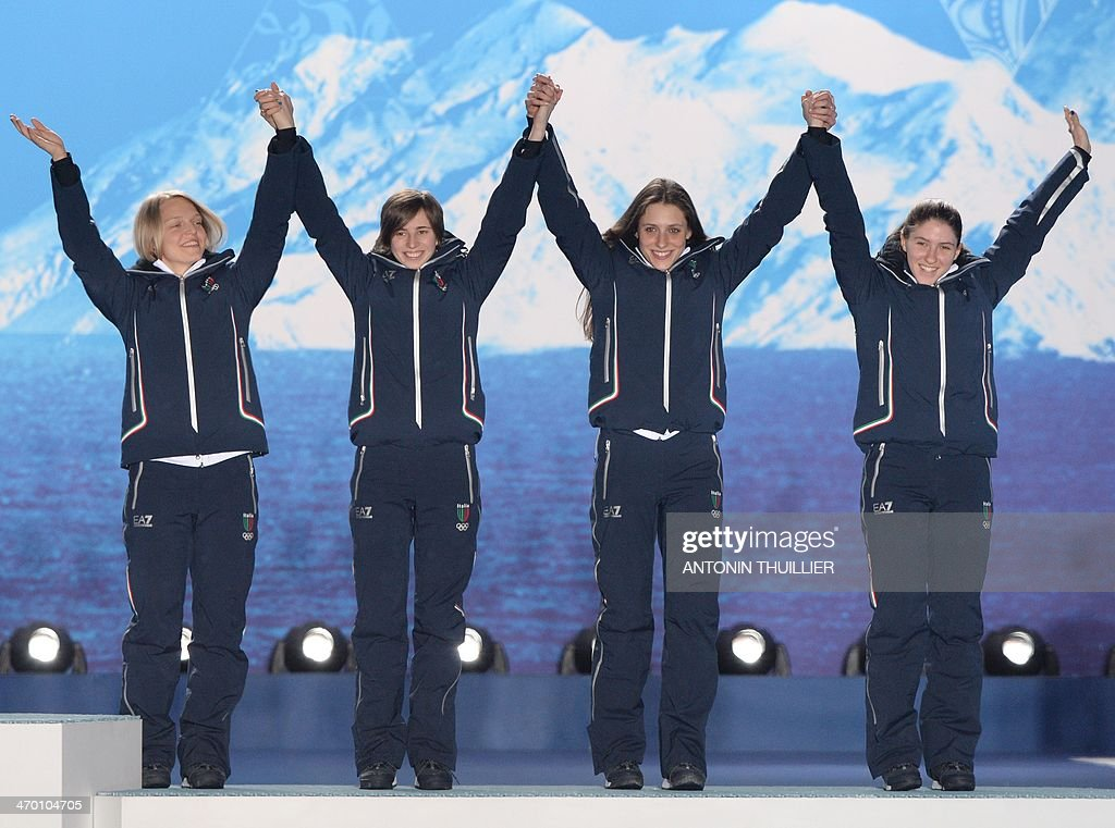 This picture taken with a robotic camera shows Italy's bronze medalists standing on the podium during the Women's Short Track 3000 m Relay Medal Ceremony at the Sochi medals plaza during the Sochi Winter Olympics on February 18, 2014.