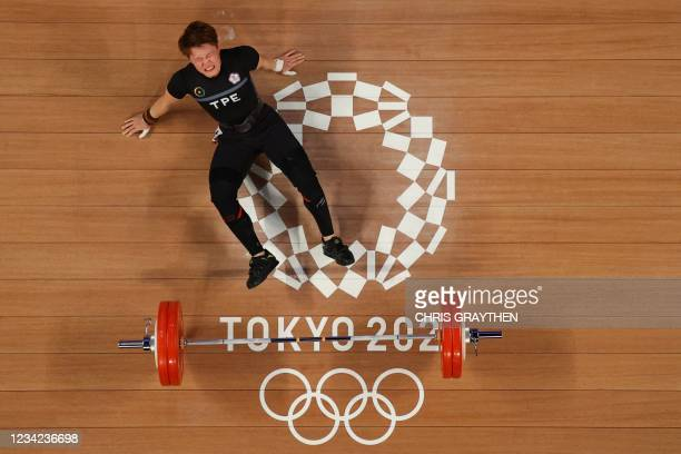 This picture taken with a robotic camera shows Taiwan's Chen Wen-huei competing in the women's 64kg weightlifting competition during the Tokyo 2020...