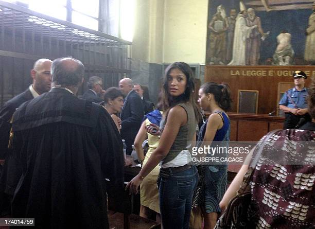 This picture taken with a smartphone shows Moroccan model Iman Fadil waiting for the sentence on the last session of the trail of former Italian...