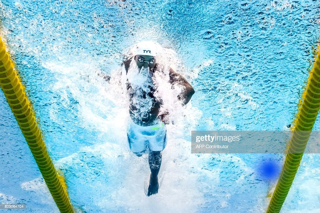 TOPSHOT - This picture taken with an underwater camera shows France's Mehdy Metella competing in a men's 100m freestyle semi-final during the swimming competition at the 2017 FINA World Championships in Budapest, on July 26, 2017. / AFP PHOTO / Martin BUREAU