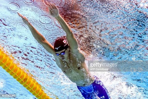TOPSHOT This picture taken with an underwater camera shows Japan's Ippei Watanabe competing in a men's 200m breaststroke heat during the swimming...