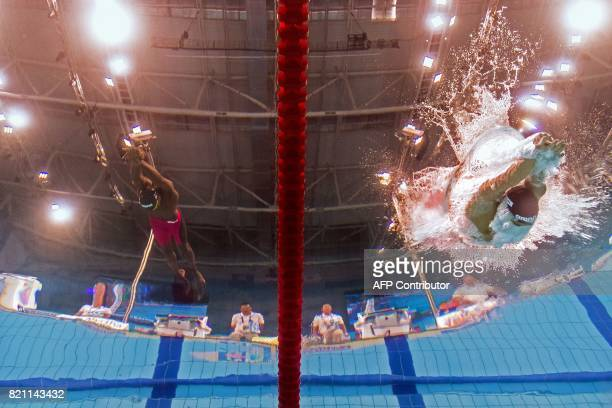 This picture taken with an underwater camera shows Niger's Alassane Seydou Lancina and Brunei's Muis Ahmad competing in a men's 100m breaststroke...