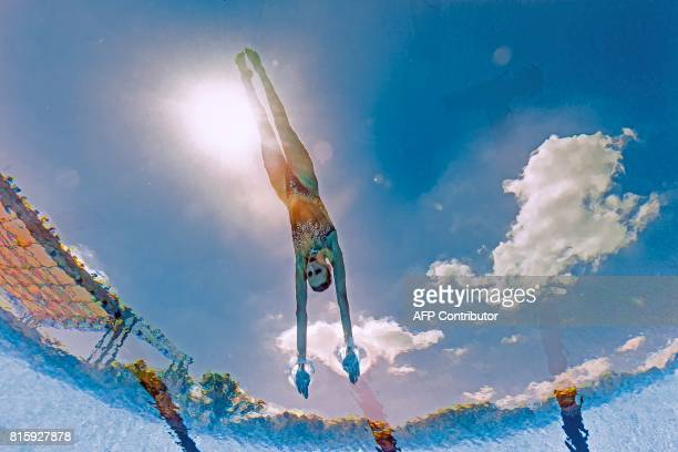 TOPSHOT This picture taken with an underwater camera shows Russia's Mikhaela Kalancha competing in the Mixed Duet technical final during the...