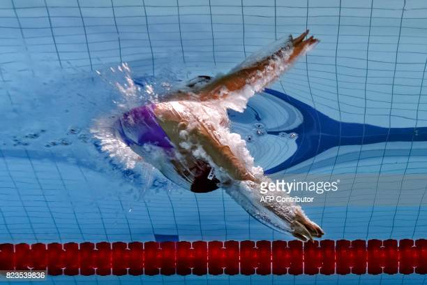 TOPSHOT This picture taken with an underwater camera shows Spain's Mireia Belmonte competing in the women's 200m butterfly final during the swimming...
