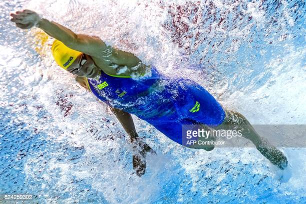 This picture taken with an underwater camera shows Sweden's Sarah Sjostrom competing in a semifinal of the women's 50m freestyle during the swimming...