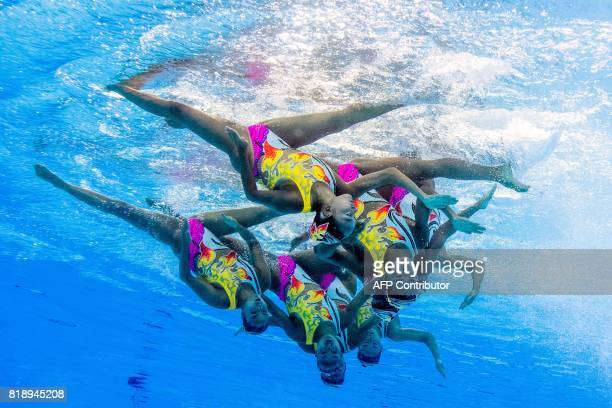 This picture taken with an underwater camera shows team Japan competing in the Women's Team Free Routine preliminary during the synchronised swimming...