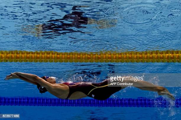 TOPSHOT This picture taken with an underwater camera shows US Regan Smith competing in the women's 200m backstroke semifinal during the swimming...