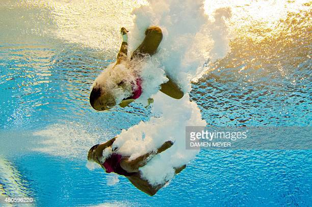 This picture taken with an underwater camera shows Yaima Mena and Annia Rivera of Cuba competing in the women's synchronized diving 10m platform...