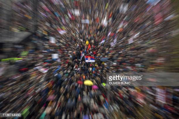 This picture taken with the zoom effect shows thousands of people from all over Serbia gathering in front of the National Assembly building in...