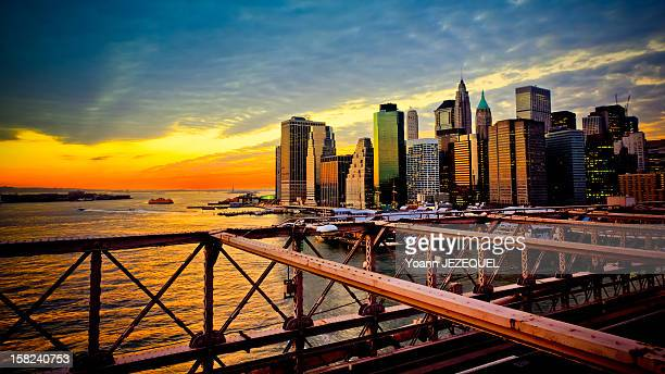 This picture was taken from the Brooklyn Bridge at the sunset during the winter The view of Manhattan was stunning The sunset light reflected on the...