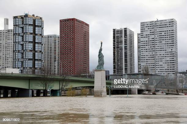 This pictures shows a general view of the 'Pont de Grenelle' bridge and the replica of the Statue of Liberty after the River Seine burst its banks in...