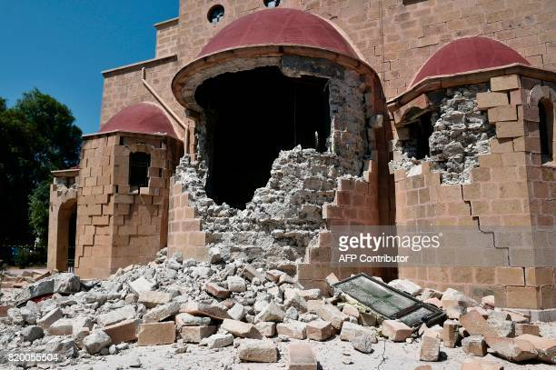 This pictures taken on July 21 2017 shows an exterior view of the quakedamaged Church of Saint Nicholas on the Greek Island of Kos following a 65...