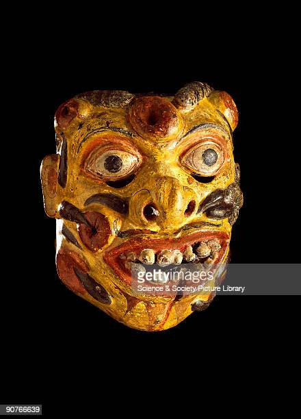 This polychrome wooden mask represents Heraya the soldier from the kolam play with his face covered in sores and leeches It was worn for healing...