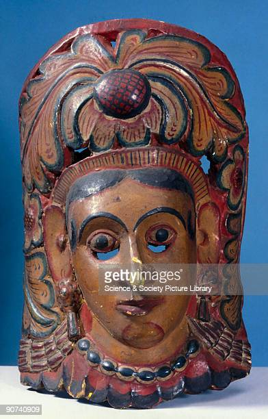 This polychrome wooden mask represents the Queen Bisava in the prelude to the kolam masked play and was worn for healing rituals In some forms of...