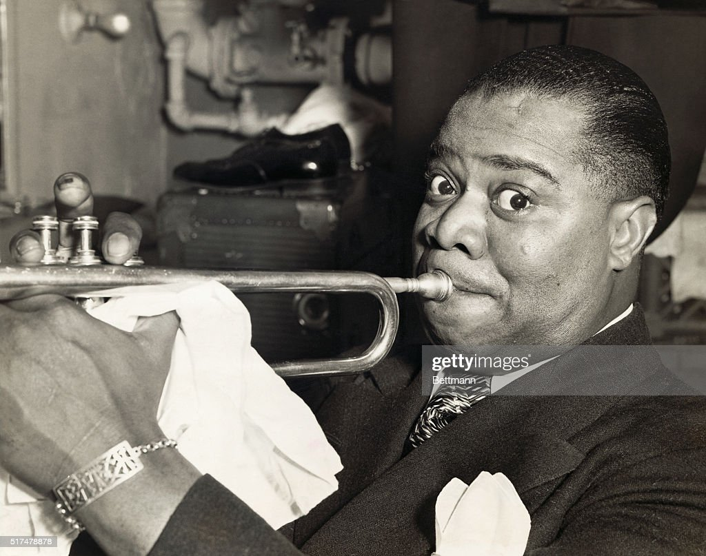 Louis Armstrong Blowing his Trumpet : News Photo