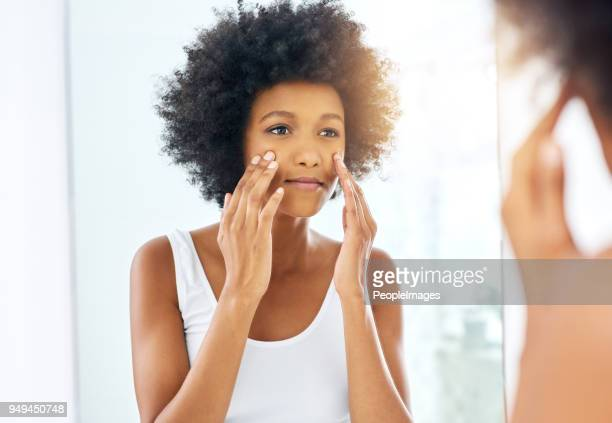 this protects my skin the entire day - light skin black woman stock photos and pictures