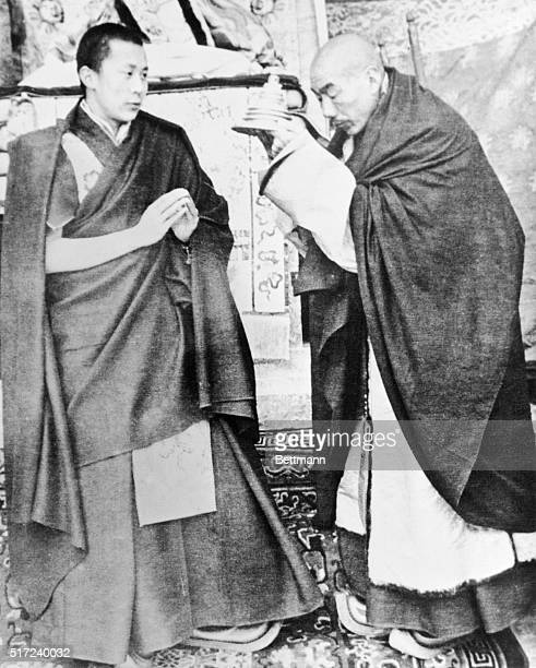 This rare snapshot of the Dalai Lama ruler of the mountain Theocracy of Tibet has been received at Yale University by Wesley E Needham the newly...
